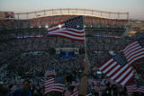 A person waves an American flag in the upper stands during the Democratic National Convention at...