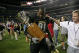 #91 Maurice Lucas (cq) of Colorado carries the Centennial Cup off the field after the Colorado...