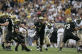 #7 Cody Hawkins (cq) loses control of a snap during the Colorado versus Colorado State college...
