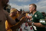 Aaron Culbertson, 22, (cq) a Colorado State Alum, argues with Colorado fans during a tailgate in...