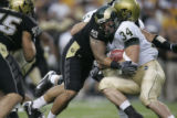 #34 Kyle Bell (cq) of CSU is tackled by #10 Michael Sipili (cq) of Colorado during the Colorado...