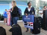 Malia Cohan (cq), middle, a delegate from San Fran. California,  waits on line to check her...
