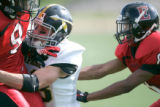 BG_0261 5A- Arapahoe  High School #13 Devin Pullara tackles Eaglecrest High School #9 Terell...