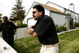 In Denver, Colo., Oct. 27, 2005 neighbor Len Madden,(cq-lt) listens to Gustavo Caldera (cq-rt) as...