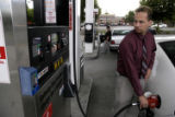 (DENVER, Colo., June 15, 2004)  John Gonzales (CQ Gonzales) pumps gasoline at the Safeway at...