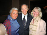 University of Denver Chancellor Daniel L. Ritchie, center, is joined by friends Carol Gossard,...
