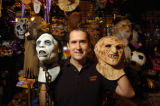 Scott Cammack (cq) holds a Day of the Dead mask (left) and a Freddy Frueger mask (right) at his...