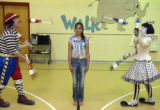 Erika Serrano, (cq), 10, CENTER, volunteered to be an obstacle in the juggling routine of Dave,...