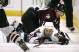 Colordao Avalanche Ossi Vaananen stays on top of Chicago Blackhawks Matt Ellison while he tries to...