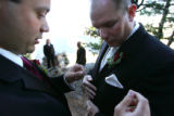 Steve Szabo, cq, 30, right, is given a hand preparing his tuxedo by his groomsmen Adriano Garcia,...