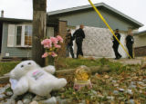 Aurora CSI personnel bring out evidence from a house at 19553 East LaSalle Dr. Sunday morning...