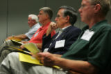 Colorado state representatives Jim Welker (cq)(R-Loveland) (white hair), left, Bill Crane (cq),...