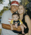 Family photo of  Teddy Guerra, Jr. his wife Adrianne Montoya , and son Teddy Guerra III (third). ...