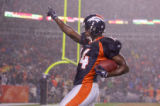 Todd Devoe celebrates as he goes into the endzone for a touchdown in the 4th quarter of the Denver...