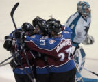 (DENVER, CO - 4/28/04) -- After scoring the game-winning goal, Colorado Avalanche Joe Sakic is...