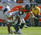 Denver Broncos John Lynch breaks up a pass to New England Patriots Davis Givens on third down...