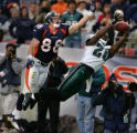 Denver Broncos Jeb Putzier, left, can't grab Jake Plummers pass as Philadelphia Eagles Brian...
