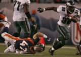The Denver Broncos safety John Lynch, left, misses a tackle on Philadelphia running back, Brian...