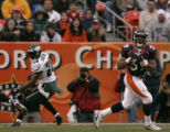 Denver Bronco full back Kyle Johnson, right, grabs a touch down pass for 6 yards with 4:35 left in...