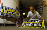 Tyler  Robb (cq) ,10 years old, puts signs together Sunday afternoon October 30, 2005 at 2993 S....