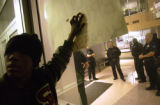 (FOREGROUND) Leonard Chapital (CQ), 13, of Denver protests the beating of Thomas Charles Armstrong...
