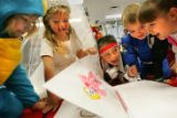 Students from Julie Winegar's Kindergarden class (from left) Lauren Graney, Allie Kopp, Nick...