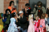Parents document costumes during a Halloween parade at Shaffer Elementary School in Highlands...