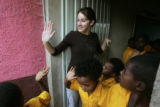 After a productive morning of teaching, Lauren Tatarsky waves goodbye to her students as they...