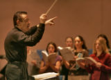 Local Denver Conductor Nicholas Laurienti directs a rehearsal with a choir for an upcoming...