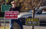 Richard Randall (cq) stands near the Arapahoe County Court Clerk   building urging voters to vote...