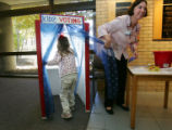 "Rachel Burns, 6, of Monument, goes into a kids election booth to cast her ""vote"" at The..."