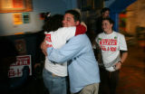 Mason Tvert, 22, director of SAFER, the group the initiated I-100, gets a heart felt hug from...