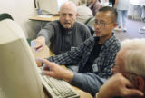 (L-R) Election official Van Alessandro (cq) Democrat, Election operator Blong Yang (cq) and...