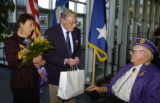 Major Robert L. Duffy and his wife Margaret  are greeted by Purple Heart holder Wayne Field...