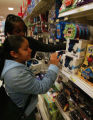 (NYT9) NEW YORK -- Nov. 2, 2005 -- CIR-GADGET-KIDS -- Teenagers in the technology toy section at...