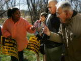 Protestor Donna Davis (cq), of Denver, left, argues with Paul Kruesi (cq), Of Golden, far right,...