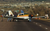 A Camanche airplane is pushed onto south bound I-25, south of Castle Rock, Wednesday afternoon...