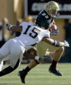 University of Colorado wide receiver Dusty Sprague, right, runs for a first down as he escapes...
