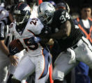 JPM0273 After intercepting Oakland Raiders Kerry Collins pass, Denver Broncos Nick Ferguson, left,...