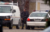 Aurora police remain in front of the family home after suspending  the search for 6-year-old...
