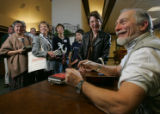 "Writer Douglas Gresham (cq), right, signs his book, called ""Jack's Life""  about the..."