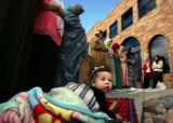 Yasmin Kemeha (cq), 6 months, of Denver, lies on a blanket while approximately 5,000 people...