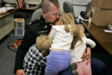 Before leaving for a funeral in December, Maj. Steve Beck took time fora hug with his children,...