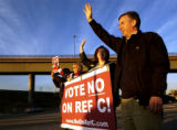 (AURORA, Colo., Oct. 31, 2005) (far-rt) Marc Holtzman (cq) along with supporters ( far-lt-rt)...