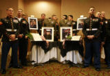 Outside a ballroom where Marines presented families with posthumous medals for their service in...