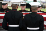 Marines from Buckley Air Force Base carry the casket of Lance Corporal Chad Maynard during funeral...
