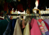 Season to Share.  Tamonia Scott (cq), 27, picks out clothing for herself, her husband, and their...