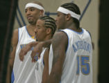 Denver Nuggets starters, left to right, Kenyon Martin, Andre Miller, and Carmelo Anthony pose for...