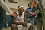 Third year Denver Nuggets forward, Carmelo Anthony, middle, answers questions during Denver...