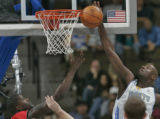 Denver Nuggets forward Francisco Elson, right, picks up his fourth block shot as he swats away...
